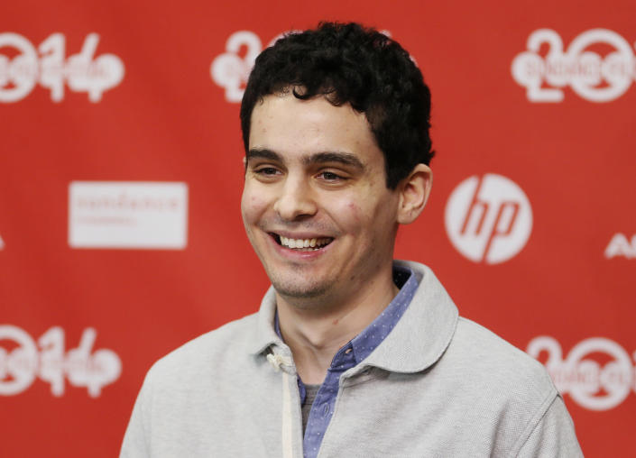 "Director and screenwriter Damien Chazelle poses at the opening night premiere of the film ""Whiplash"" during the 2014 Sundance Film Festival, on Thursday, Jan. 16, 2014, in Park City, Utah. (Photo by Danny Moloshok/Invision/AP)"