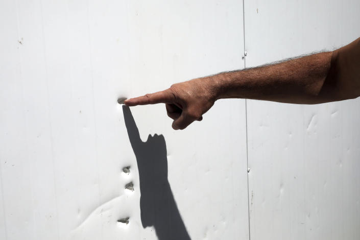 In this Wednesday, June 3, 2020 photo, bullet holes on a wall in Jerusalem's old city where Eyad Hallaq was fatally shot. Early Saturday, Hallaq, a 32-year-old Palestinian with severe autism, was chased by Israeli border police forces into a nook in Jerusalem's Old City and fatally shot as he cowered next to a garbage bin after apparently being mistaken as an attacker. He was just a few meters from his beloved Elwyn El Quds school. (AP Photo/Mahmoud Illean)