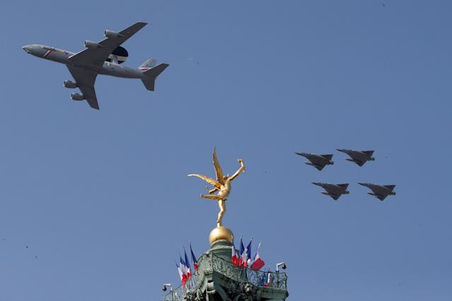 "<p>A Boeing AWACS 1E-3F and Mirage 2000 jet fighters fly past the ""Genie de la Liberte""(Spirit of Freedom) gilded figure on top of the Place de la Bastille's July Column in Paris during the traditional Bastille Day military parade in Paris, France, July 14, 2018. (Photo: Pascal Rossignol/Reuters) </p>"