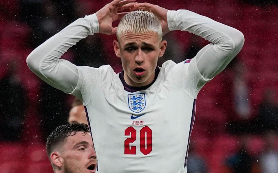 England's midfielder Phil Foden reacts during the UEFA EURO 2020 Group D football match between England and Scotland at Wembley - FRANK AUGSTEIN/POOL/AFP via Getty Images