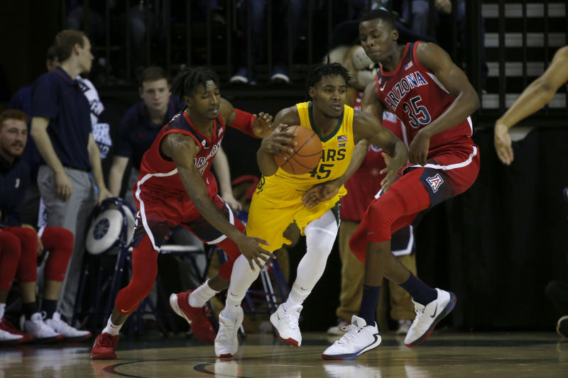 Baylor guard Davion Mitchell (45) tries to get past Arizona guard Dylan Smith (3) and Arizona center Christian Koloko (35) during the first half of an NCAA college basketball game in Waco, Texas, Saturday, Dec. 7, 2019. (AP Photo/Michael Ainsworth)