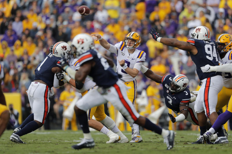 LSU quarterback Joe Burrow (9) passes under pressure from Auburn defensive end Marlon Davidson (3) in the first half of an NCAA college football game in Baton Rouge, La., Saturday, Oct. 26, 2019. (AP Photo/Gerald Herbert)
