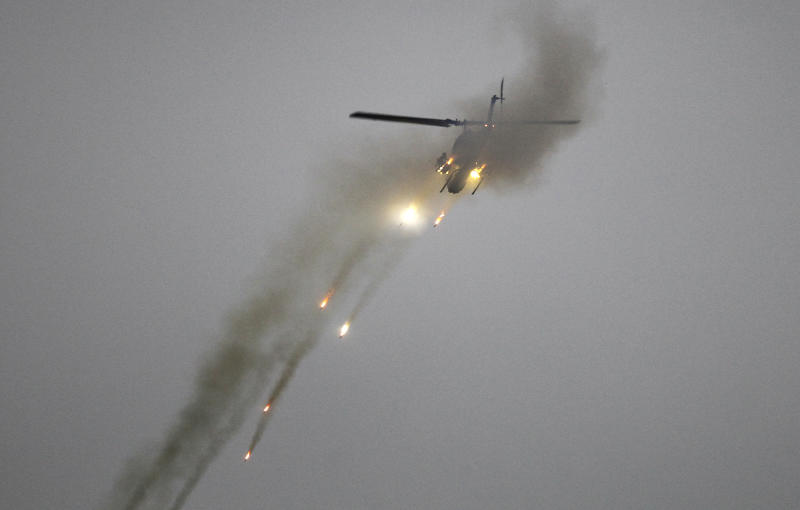 Taiwan's AH-1W Cobra attack helicopter fires during a military exercises in Taichung, central Taiwan, Thursday, Jan. 17, 2019. Taiwan's military has conducted a live-fire drill on Thursday to show its determination to defend itself from Chinese threats. (AP Photo/Chiang Ying-ying)