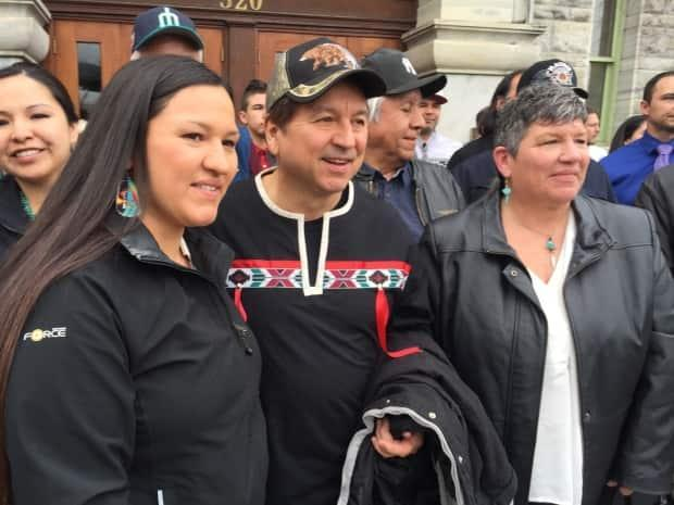 Richard Desautel, middle, a Sinixt man from Washington state, stands outside the Nelson, B.C., courthouse with members of the Colville Confederated Tribes after his acquittal at the trial level on March 27, 2017.