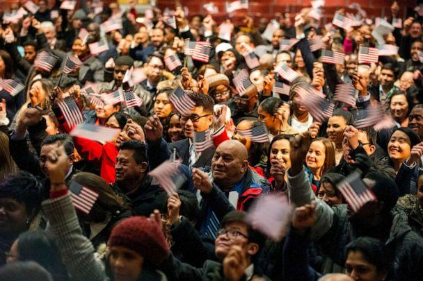 PHOTO: In this Januaruy 22, 2019, file photo, newly sworn-in U.S. citizens celebrate and wave US flags during a naturalization ceremony where 633 immigrants became US citizens,at the Lowell Auditorium, in Lowell, Massachusetts. (Joseph Prezioso/AFP/Getty Images, FILE)