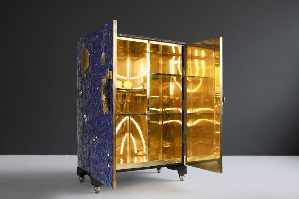 A look inside the Midas-worthy cabinet.