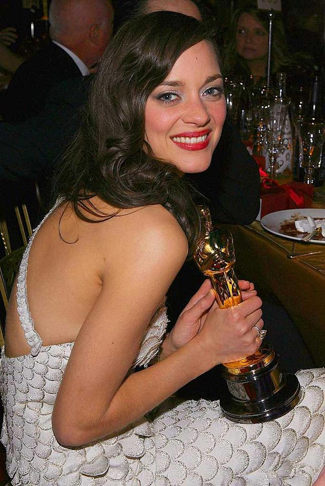 """French beauty Marion Cotillard was still glowing from compliments hours after she won the Best Actress prize. Frazer Harrison/<a href=""""http://www.gettyimages.com/"""" target=""""new"""">GettyImages.com</a> - February 24, 2008"""