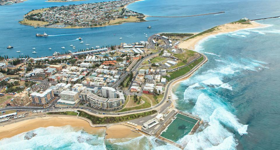 Aerial view from a helicopter of Newcastle Beach and coastline including the ocean swimming pool in New South Wales, Australia. Source: Getty Images