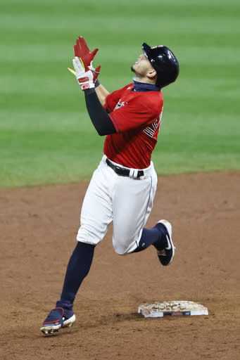 Cleveland Indians' Cesar Hernandez celebrates after hitting a winning single off Pittsburgh Pirates relief pitcher Chris Stratton during the ninth inning of a baseball game, Friday, Sept. 25, 2020, in Cleveland. (AP Photo/Ron Schwane)