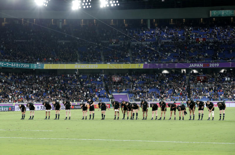 New Zealand's players bow to the crowd at the end of the Rugby World Cup Pool B game against South Africa in Yokohama, Japan, Saturday, Sept. 21, 2019. (AP Photo/Shuji Kajiyama)