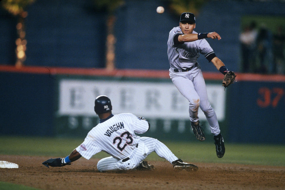 Yankees shortstop Derek Jeter turns a double play during the 1998 World Series.
