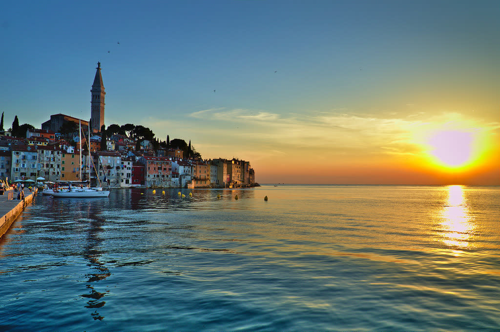 """<p>The fishing port of Rovinj is an idyllic town with cobbled streets heading up to the church of St Euphemia that stands atop the hill. Lone Bay is to the south of the old town and has a beautiful pebble beach. Rovinj in Coratia is number eight of the top emerging destinations according to TripAdvisor.<br />Photograph: <a rel=""""nofollow"""" href=""""https://www.flickr.com/photos/132549859@N07/29857403402/sizes/l"""">SN6200/Flickr (Under Creative Commons License)</a> </p>"""