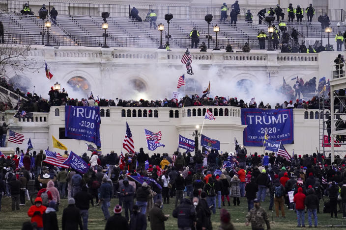 FILE - In this Jan. 6, 2021, file photo, violent protesters, loyal to then-President Donald Trump, storm the Capitol, Wednesday, Jan. 6, 2021, in Washington. A Drug Enforcement Administration agent arrested on charges stemming from the Jan. 6 riot at the U.S. Capitol is accused of posing for photographs in which he flashed his DEA badge and firearm outside the building while off duty. Court records show the agent, Mark Sami Ibrahim, was arrested in Washington, D.C., on charges including making a false statement to investigators. (AP Photo/John Minchillo, File)