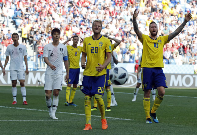 Sweden's Ola Toivonen, centre, and Pontus Jansson react to a missed chance during the group F match between Sweden and South Korea at the 2018 soccer World Cup in the Nizhny Novgorod stadium in Nizhny Novgorod, Russia, Monday, June 18, 2018. (AP Photo/Pavel Golovkin)