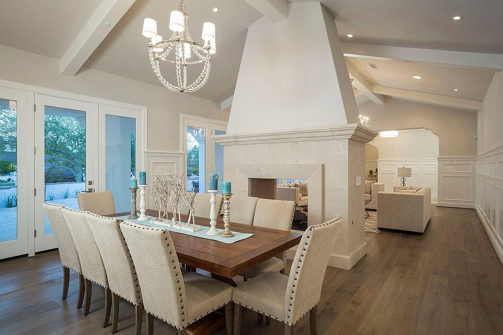 <p>Here, we get a look inside Phelps's stunning dining area. With a stand-alone fireplace as the room's vocal point, this space offers a sophisticated place for dinner parties.</p>