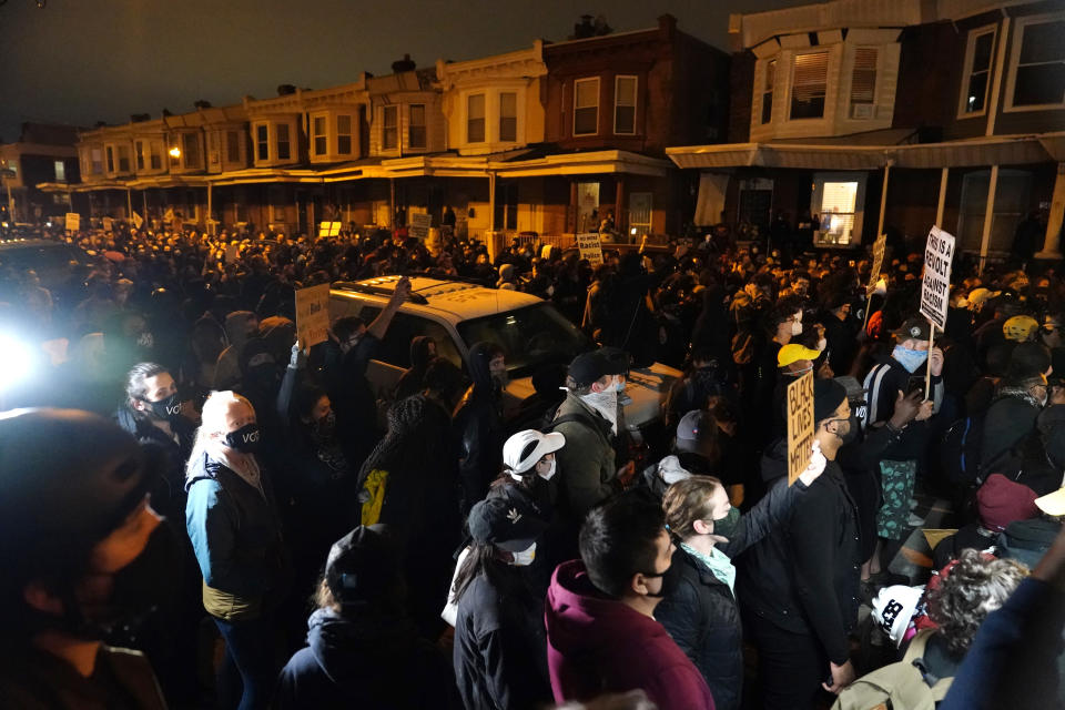 Protesters confront police during a march Tuesday, Oct. 27, 2020, in Philadelphia. Hundreds of demonstrators marched in West Philadelphia over the death of Walter Wallace, a Black man who was killed by police in Philadelphia on Monday. Police shot and killed the 27-year-old on a Philadelphia street after yelling at him to drop his knife. (AP Photo/Matt Slocum)