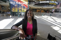 FILE - In this June 26, 2019 file photo, Tamika Catchings poses for a photo inside Banker's Life Fieldhouse in Indianapolis. Catchings is part of a nine-person group announced Saturday, April 4, 2020, as this years class of enshrinees into the Naismith Memorial Basketball Hall of Fame. (AP Photo/Darron Cummings, File)