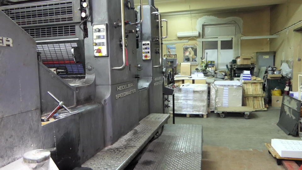 In this photo provided by Bulgaria's Interior Ministry on Tuesday, March 16, 2021, the interior a printing office in a university, in Sofia. Bulgarian authorities say they have seized high-quality forged banknotes produced at a printing office in a university in the Bulgarian capital. In a joint operation with U.S. Secret Service, Bulgarian police detained two people and seized a printing machine and equipment for printing money, along with large amounts of counterfeit U.S. dollar and euro notes. (Bulgarian Interior Ministry via AP)