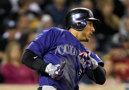 Colorado Rockies' Carlos Gonzalez has nothing but the handle left of his bat on a swing that resulted in a run producing single to center against the San Diego Padres in the sixth inning of a baseball game Monday, May 7, 2012 in San Diego. (AP Photo/Lenny Ignelzi)