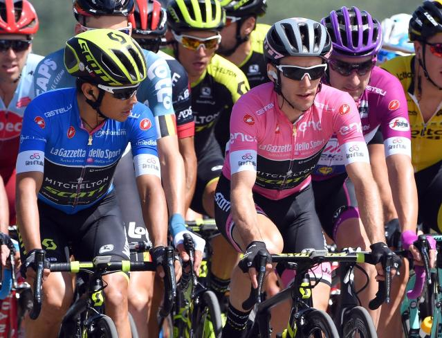 Britain's Simon Yates, wearing the pink jersey of the overall leader, pedals alongside Colombia's Johan Esteban Chaves Rubio, left, and Italy's Elia Viviani, right, during the 10th stage of the Giro d'Italia cycling race, from Penne to Gualdo Tadino d'Italia, Italy, Tuesday, May 15, 2018. (Daniel Dal Zennaro/ANSA via AP)