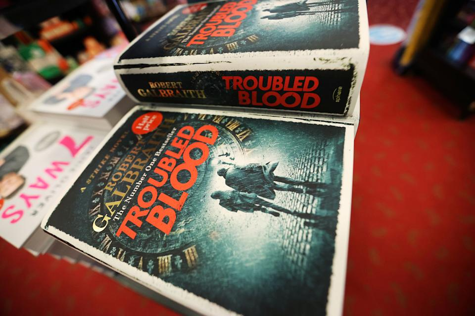 """J.K. Rowling's latest book, """"Troubled Blood,"""" written under the pseudonym Robert Galbraith, is pictured at a bookstore in Hanley, Stoke-on-Trent, Britain, on Sept. 15. (Photo: Carl Recine / reuters)"""