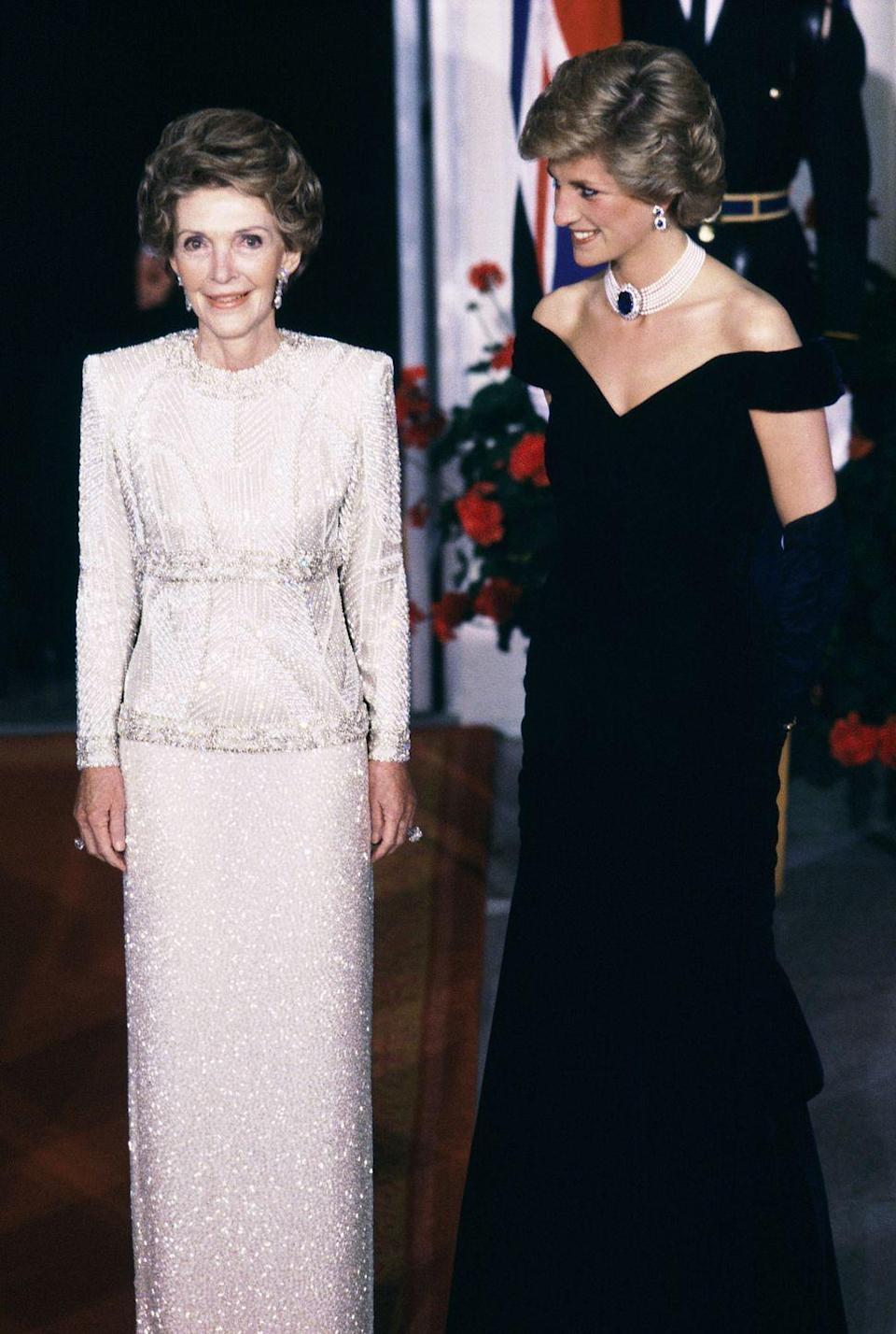 <p>A White House state dinner brought First Lady Nancy Reagan and Princess Diana together. The First Lady wore a long sleeve beaded evening gown, while the Princess had on a midnight blue velvet off-the-shoulder Victor Edelstein dress.</p>