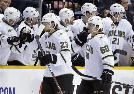 Dallas Stars center Tom Wandell (23), of Sweden, and left wing Antoine Roussel (60), of France, celebrate after Wandell scored against the Nashville Predators in the second period of an NHL hockey game on Friday, April 12, 2013, in Nashville, Tenn. (AP Photo/Mark Humphrey)