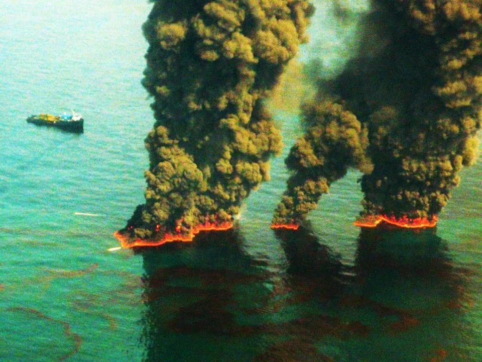 Plumes of smoke rise from a controlled burn during the Deepwater Horizon oil spill in 2010 (Getty)