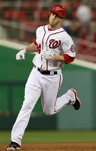 Washington Nationals left fielder Bryce Harper rounds the bases after hitting his first major-league home run during the third inning of baseball game against the San Diego Padres, Monday, May 14, 2012 in Washington. (AP Photo/Haraz N. Ghanbari)