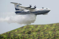 An AG600 drops a payload of water during a performance for the 13th China International Aviation and Aerospace Exhibition, also known as Airshow China 2021, on Tuesday, Sept. 28, 2021 in Zhuhai in southern China's Guangdong province. (AP Photo/Ng Han Guan)