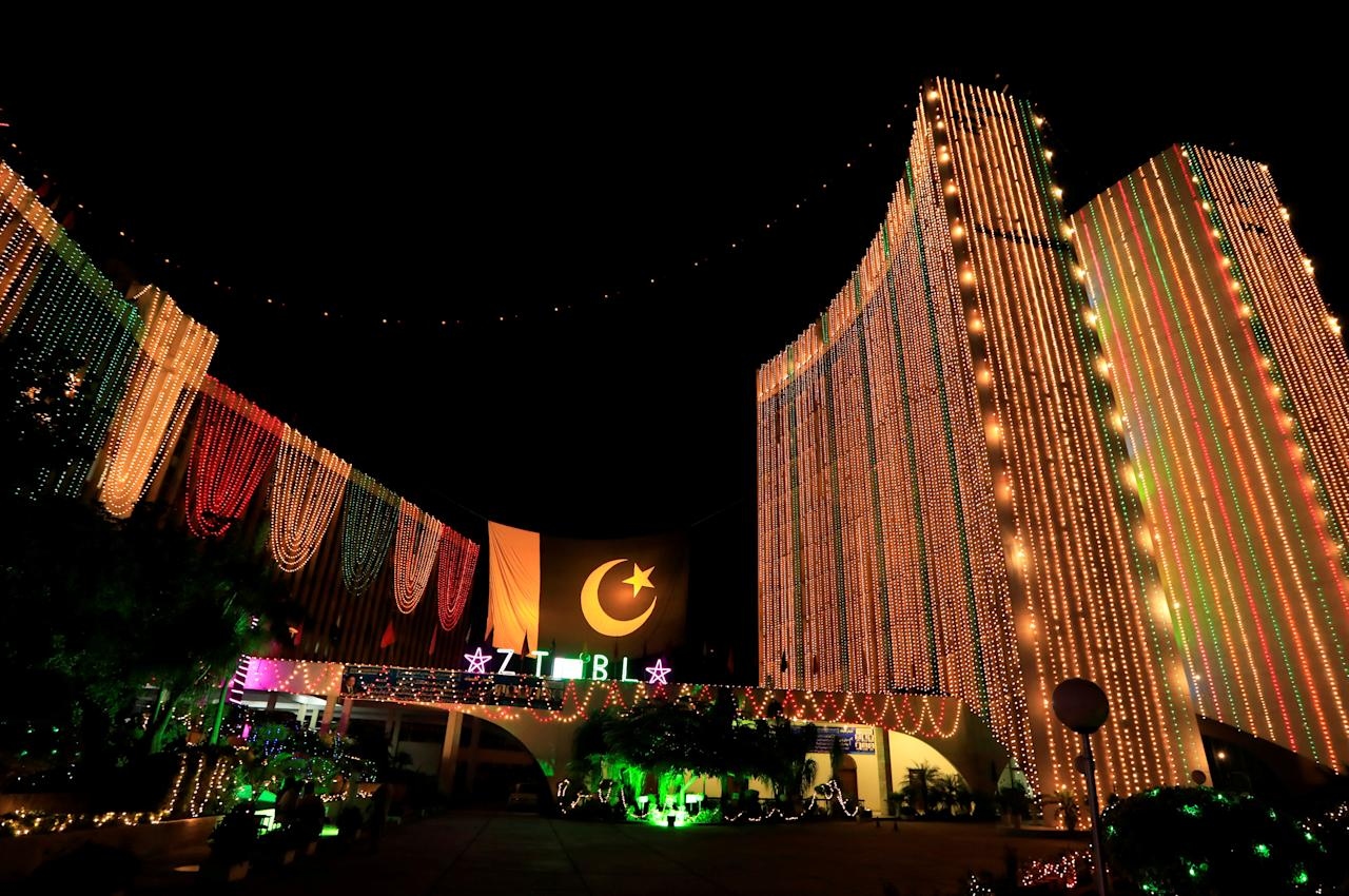 FILE PHOTO: An illuminated building is seen on the eve of the Independence Day in Islamabad, Pakistan August 14, 2018.  REUTERS/Faisal Mahmood/File Photo