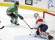 Dallas Stars left wing Blake Comeau (15) shoots against Florida Panthers goaltender Chris Driedger (60) in the second period during an NHL hockey game on Sunday, March 28, 2021, in Dallas. (AP Photo/Richard W. Rodriguez)