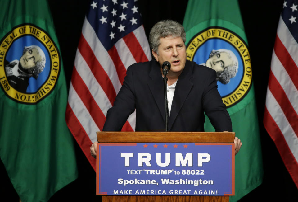 Mike Leach head football coach at Washington State University, speaks in support of Republican presidential candidate Donald Trump during a rally in Spokane, Wash., Saturday, May 7, 2016. (AP Photo/Ted S. Warren)