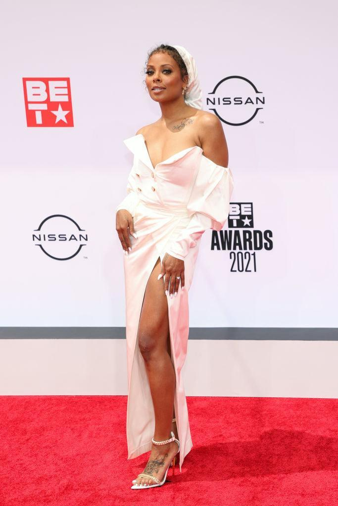Eva Marcille attends the BET Awards 2021 in a strapless dress and matching head scarf