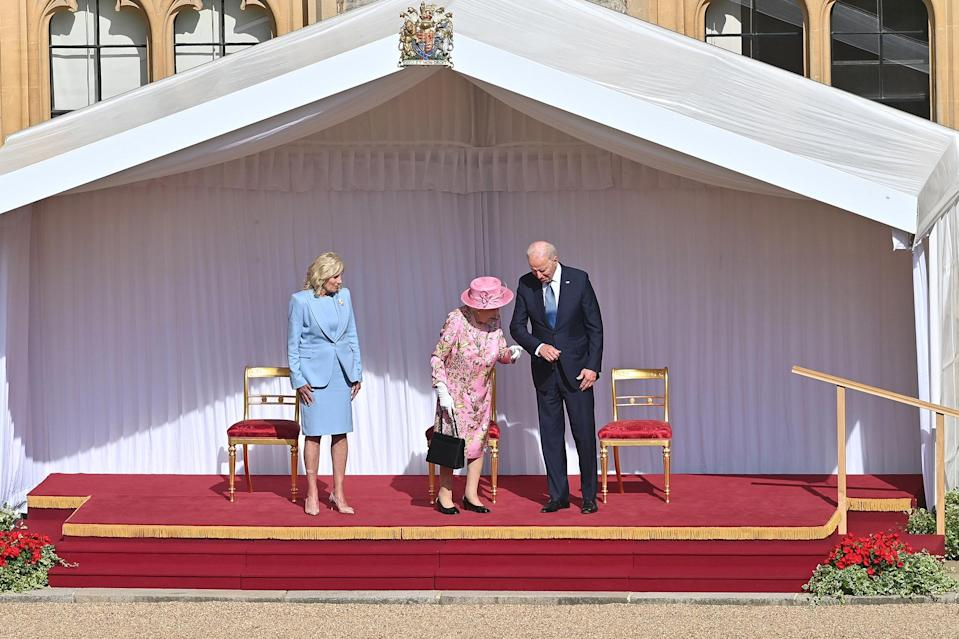 <p>President Biden held the Queen's arm as they made their way inside for afternoon tea inside the 1,000-year-old castle. </p>