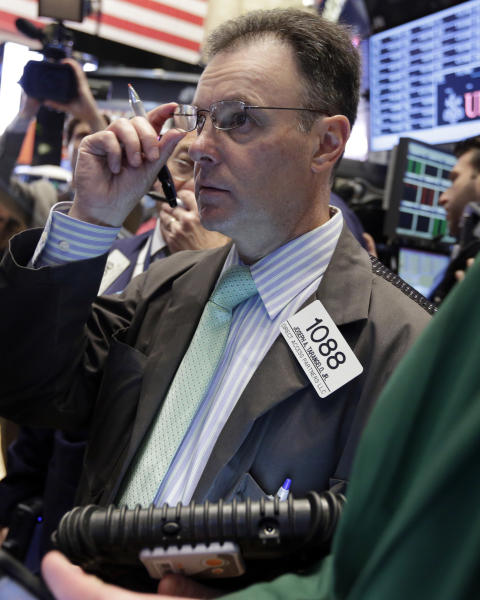 Trader Joseph Tarangelo works on the floor of the New York Stock Exchange Thursday, May 2, 2013. Stocks are opening higher on Wall Street, a day after the market's biggest fall in two weeks, after General Motors and other big companies announced higher profits. (AP Photo/Richard Drew)
