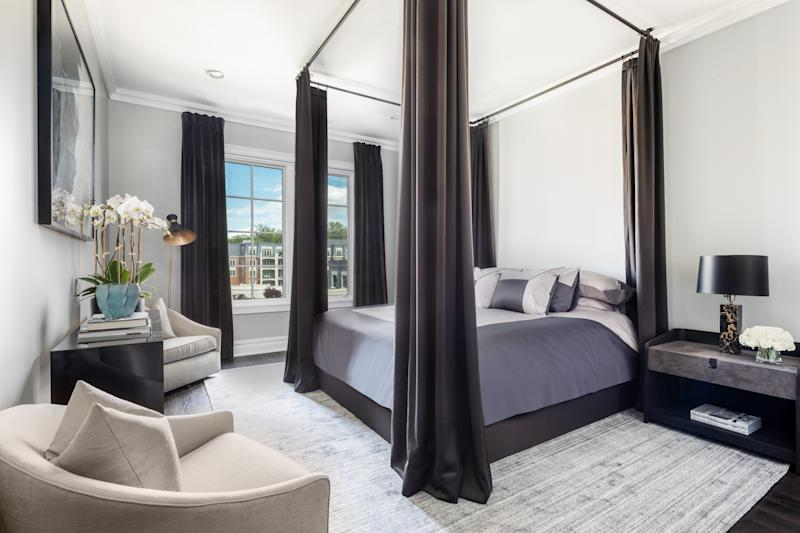 In the master bedroom by Ryan Korban, the four-poster bed rises to meet the high ceilings.