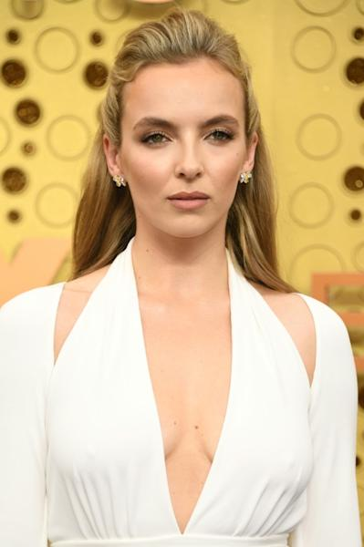 British actress Jodie Comer wore a white Tom Ford gown to the 2019 Emmys; she is a nominee again this year, but she won't have a traditional red carpet moment