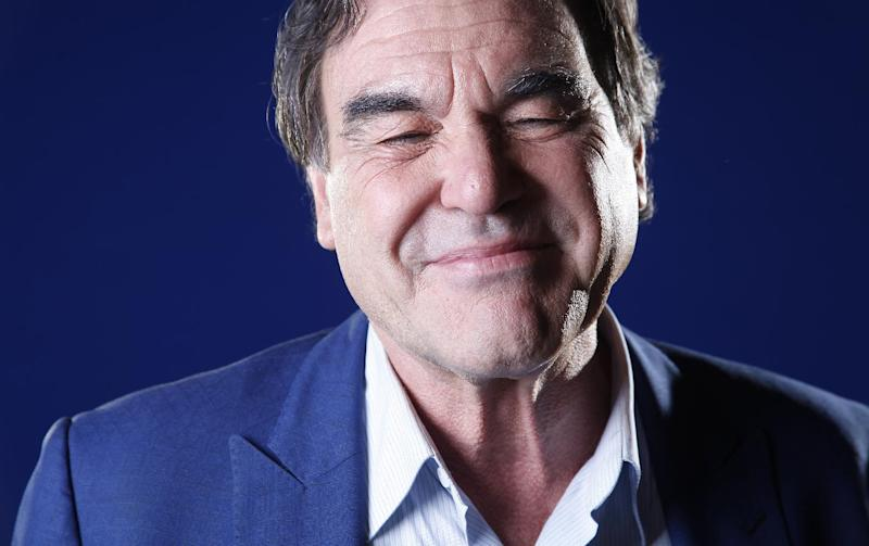 "In this Wednesday, Nov. 14, 2012, photo, American film director, screenwriter and producer Oliver Stone poses for a portrait in New York. Oliver Stone has never been shy about ruffling feathers with his take real-life events. From ""J.F.K"" and ""Nixon,"" to ""Salvador"" and ""W,"" Stone has challenged the history that we know by incorporating a revisionist view. His latest project, ""The Untold History of the United States,"" a ten-part series, currently on the premium Showtime network, explores the facts he feels were suppressed for one reason or another. (Photo by Carlo Allegri/Invision/AP)"