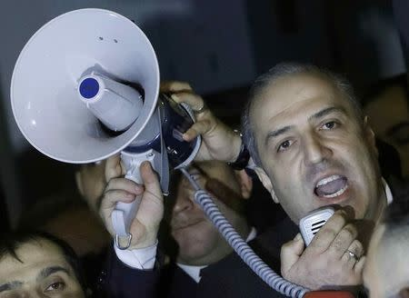 Turkey's ambassador to the Netherlands Sadik Arslan addresses crowds outside the Turkish consulate in Rotterdam, Netherlands March 11, 2017.     REUTERS/Yves Herman