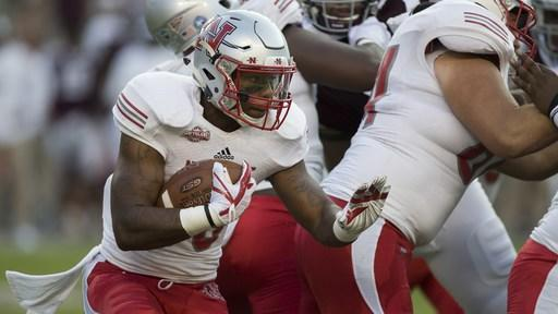 Nicholls State running back Kyran Irvin (30) carries the ball against Texas A&M during the first quarter of an NCAA college football game Saturday, Sept. 9, 2017, in College Station, Texas. (AP Photo/Sam Craft)
