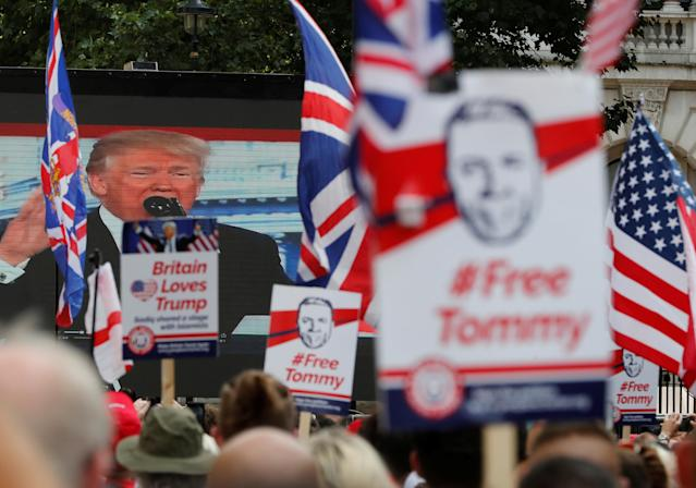 <p>Demonstrators hold placards supporting English Defense League founder Tommy Robinson and President Trump in London, Britain July 14, 2018. (Photo: Yves Herman/Reuters) </p>