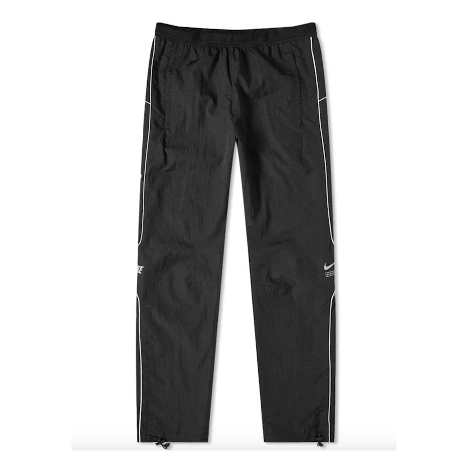 """<p><strong>Nike</strong></p><p>endclothing.com</p><p><strong>$75.00</strong></p><p><a href=""""https://go.redirectingat.com?id=74968X1596630&url=https%3A%2F%2Fwww.endclothing.com%2Fus%2Fnike-dna-woven-pant-ct9959-010.html&sref=https%3A%2F%2Fwww.esquire.com%2Fstyle%2Fmens-fashion%2Fg34645350%2Fbest-performance-pants-men%2F"""" rel=""""nofollow noopener"""" target=""""_blank"""" data-ylk=""""slk:Buy"""" class=""""link rapid-noclick-resp"""">Buy</a></p><p>A throwback design that manages to reference the best of the early aughts without wantonly embracing the era's more mortifying moments. </p>"""