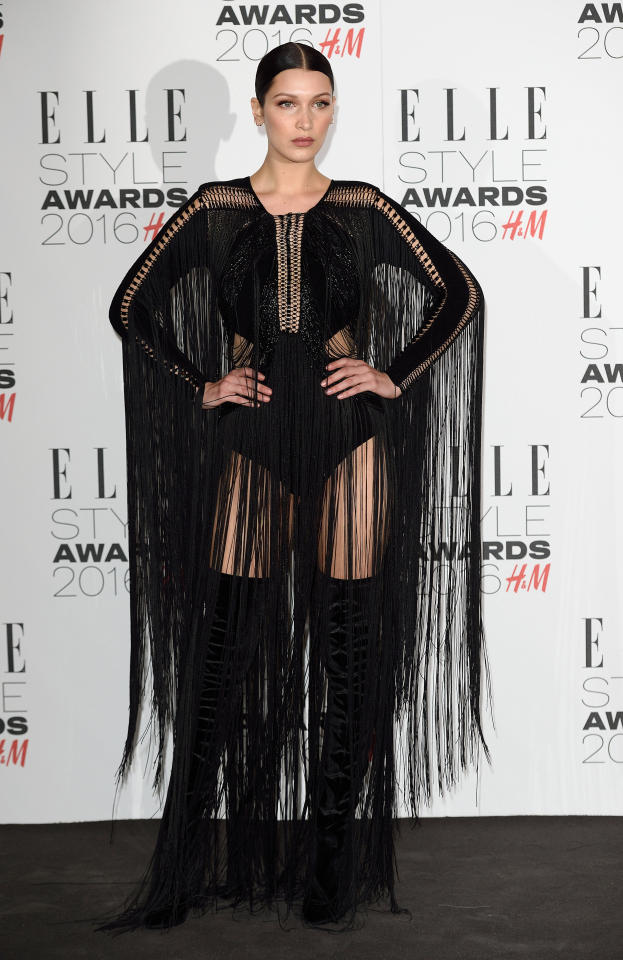 <p>Hadid left little to the imagination in a dominatrix-inspired black leotard with fringe. (<i>Photo: Getty Images</i>)</p>