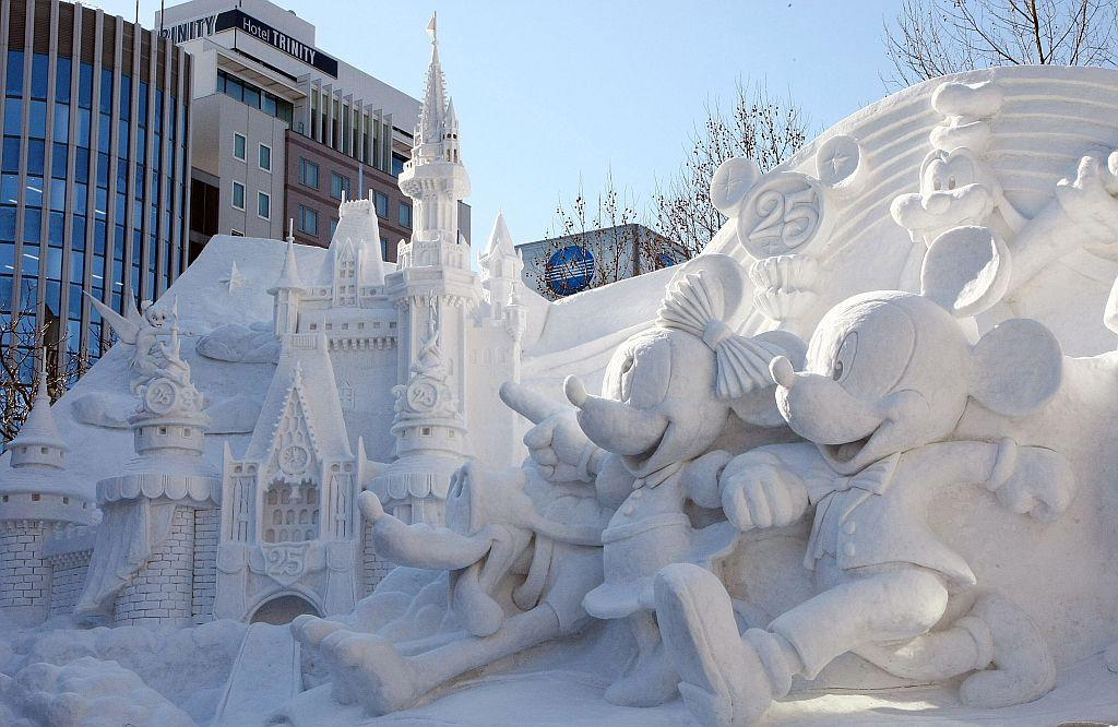 Ice sculptures od Disney characters are displayed ahead of the opening of the 60th Sapporo Snow Festival at Odori Park in Sapporo, Japan.
