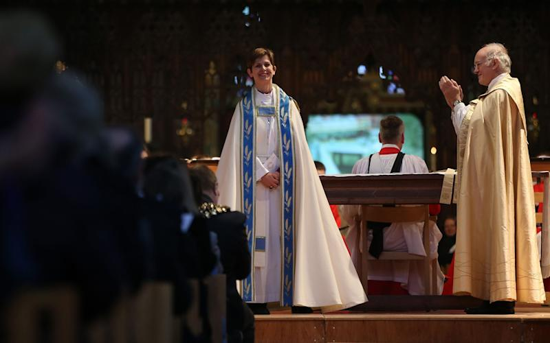 Bishop Libby Lane (centre) is formally installed at Chester Cathedral in Cheshire, as the Church of England's first woman bishop - Credit: Lynne Cameron