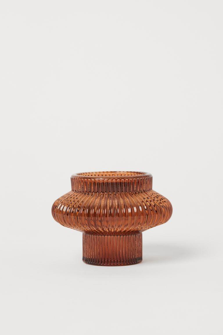 """<strong>Jacqueline Kilikita, Beauty Editor</strong><br><br><strong>Under £10</strong><br><br>So many candles, so little candle holders. I like these vintage-inspired, terracotta glass versions, which would look very pretty dotted around the house.<br><br><strong>H&M</strong> Glass candle lantern, $, available at <a href=""""https://www2.hm.com/en_gb/productpage.0897504014.html"""" rel=""""nofollow noopener"""" target=""""_blank"""" data-ylk=""""slk:H&M"""" class=""""link rapid-noclick-resp"""">H&M</a>"""
