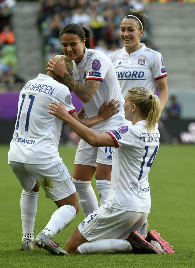 CORRECTS PHOTOGRAPHERS NAME -- Ada Hegerberg of Lyon, right, celebrates her goal with teammates Shanice van de Sanden, left, Lucy Bronze, rear center, and Dzsenifer Marozsan, rear right, during the women's soccer UEFA Champions League final match between Olympique Lyon and FC Barcelona at the Groupama Arena in Budapest, Hungary, Saturday, May 18, 2019. (Balazs Czagany/MTI via AP)