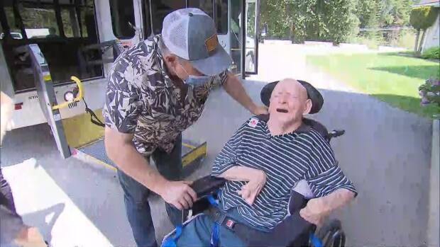 Gord Zaitsoff greets his uncle, Paul Zaitsoff, as he returns to his long-term care home after it was evacuated because of a wildfire. Gord Zaitsoff says the basement where residents like his dad were temporarily placed was unacceptable.  (CBC News - image credit)