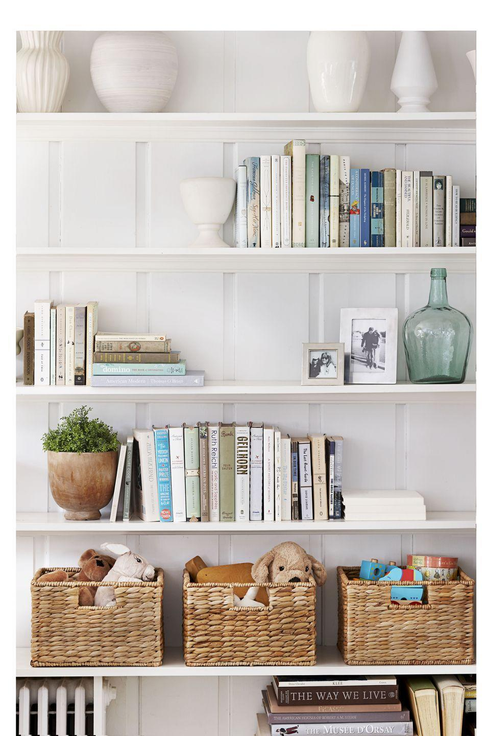 <p>Design pros know not to let books take over shelves without weaving in a few stylish decor accents. Think ceramics, glass vases, framed photos, and woven baskets to corral toys. </p>
